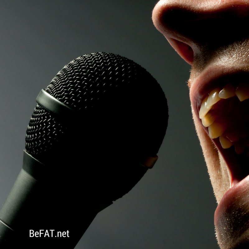 person singing into microphone.jpg